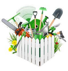 white wooden fence with garden accessories vector image