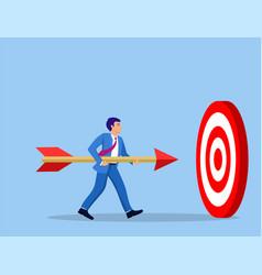 Businessman aim arrow to target vector