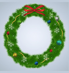 green christmas wreath with ornaments and red vector image