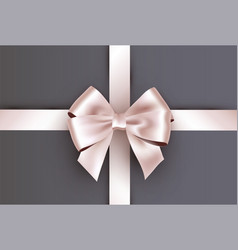 Shiny ivory white satin ribbon on gray background vector