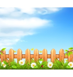 Spring background grass and wooden fence vector image vector image
