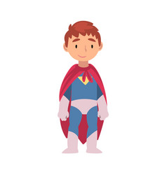Boy in a superhero costume stands cartoon vector