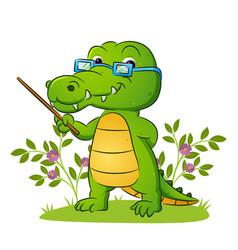 Old teacher crocodile is teaching vector