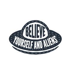Believe in yourself and aliens - calligraphy vector