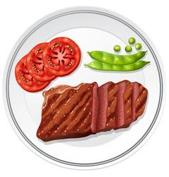 Steak and fresh vegetables on plate vector