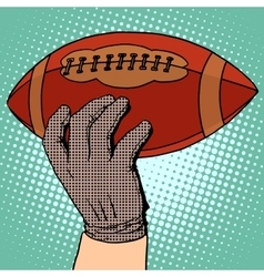 The ball of American football in his hand vector image vector image