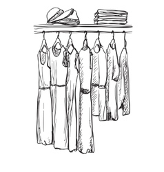 Fashionable clothes for women on hangers vector image