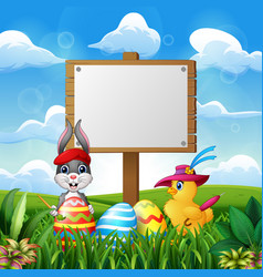 happy easter bunny and chick with blank sign on th vector image