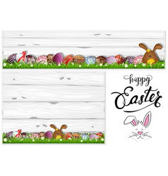 easter eggs on grass and wooden background vector image