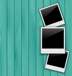 Three blank photo frames on wooden background vector image vector image