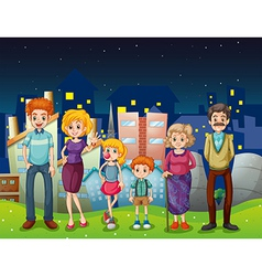 A happy family near the tall buildings in the city vector image
