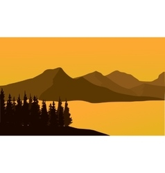 Silhouette of mountain at sunset vector