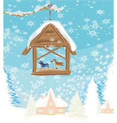 Birdfeeder in winter vector image