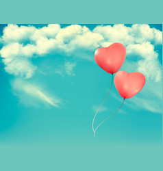 valentine heart-shaped balloons in a blue sky vector image
