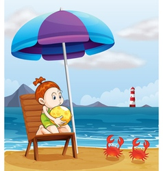 A young girl holding a beach ball at the beach vector image