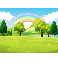 Nature scene of a park with rainbow vector image vector image