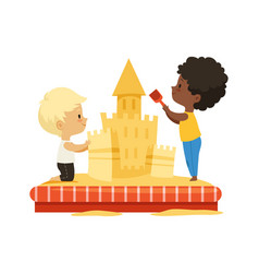 boys building sand castle children play together vector image
