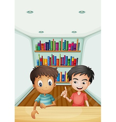 Two boys in front of the bookshelves with books vector image