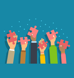 People raised arms holding jigsaw puzzle pieces vector