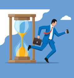Businessman and hourglass vector