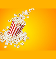 full striped bucket with falling popcorn vector image