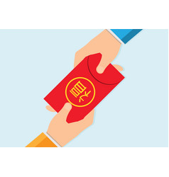 Hand holding chinese new year red money packet vector