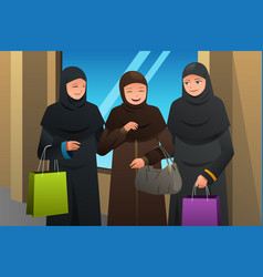 Muslim women going shopping at the mall vector