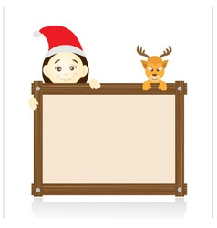 Santa claus and reindeer holding wood board on vector image