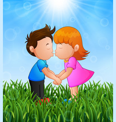 cartoon little boy and girl kissing in the grass o vector image