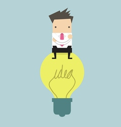 Businessman sitting on idea bulb vector image
