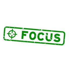 Grunge green focus word with scope icon square vector