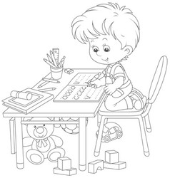 boy doing homework after his game with toys vector image