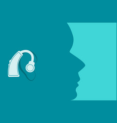 Head with a hearing aid in ear vector