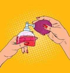 pop art woman hands with bottle of luxury perfume vector image