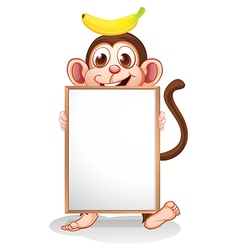 A monkey with a banana above his head holding an vector image vector image