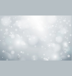 abstract bokeh and snowflakes in white background vector image