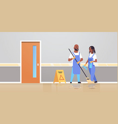 couple cleaners in uniform working together vector image