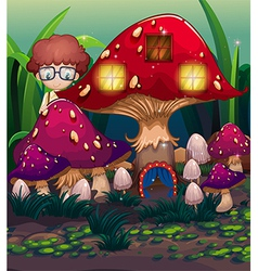 A boy at the back of the mushroom house vector