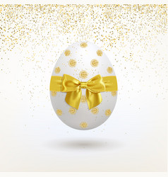 Easter egg with a golden bow and a falling golden vector