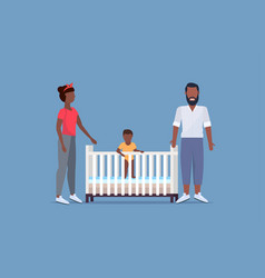 Father mother and their newborn baby in crib vector