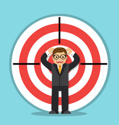 Businessman in the center of the target vector