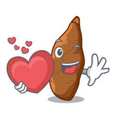 with heart ripe cassava on the cartoon table vector image