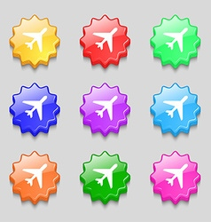 Airplane icon sign symbol on nine wavy colourful vector