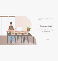 woman sitting at kitchen counter desk working vector image