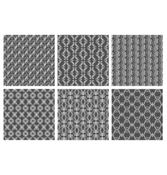 ornamental white floral pattern set on gray vector image