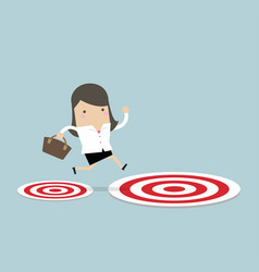 businesswoman jumping from to the big target vector image