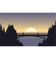 Silhouette of bridge and moon vector image