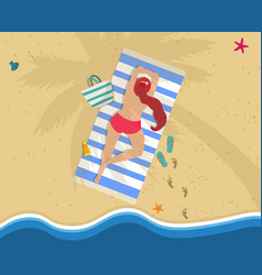 Woman in red bikini lying on belly at beach towel vector
