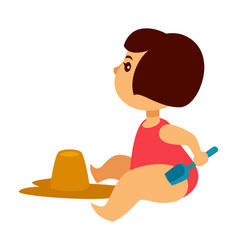baby girl in swimsuit builds castle of sand vector image