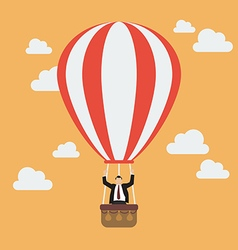 Businessman celebrating in hot air balloon vector image